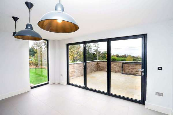 Close up of grey aluminium bifold doors.