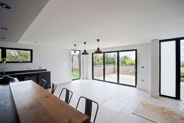 Open plan living space complete with aluminium bifold doors to create flow between the indoor and outdoor space.