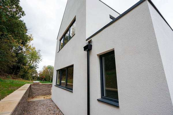 Rear view of the property, 3 larger aluminium windows have been installed here in RAL 7016 grey contrasting perfectly against the cream k-rend.