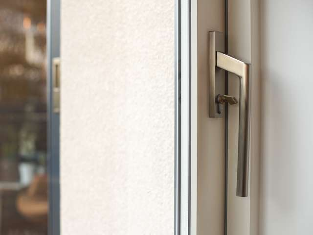 Close up of stainless steel sliding door handle.