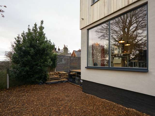 External view of large alu-clad timber window from Rationel.