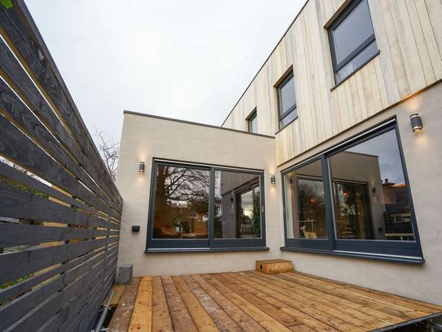 Rear entertaining areas with dual Rationel alu-clad timber sliding door supplied and fitted in West Kirby, Wirral.