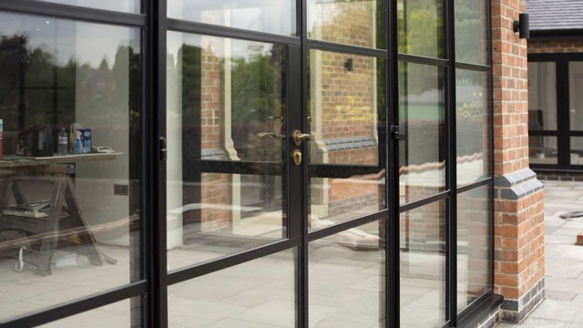 Close up showing the glazing bar details on the large Crittall screen.