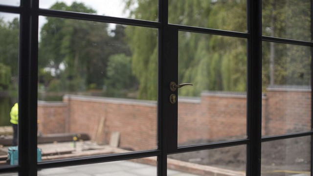 Close up showing the brass look handle on the Crittall screen.