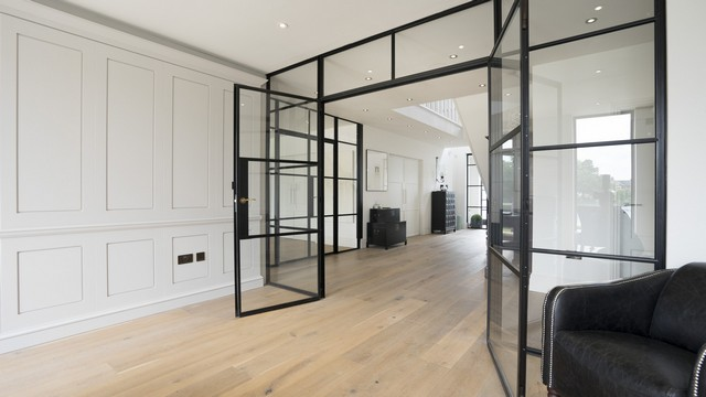 The dark crittall screens contrasting well with the wall panelling.