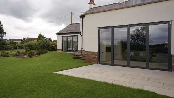 Close up of the Centor bifold doors in RAL 7016.