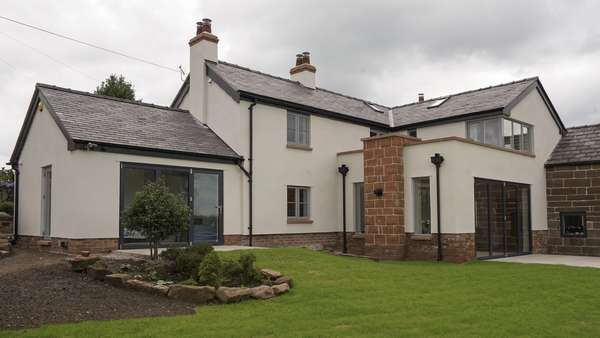 Main shot of the rear of the house showing the dual Centor bifolding doors, various Rationel windows with feature glazing bar and stunning corner window to the second floor.