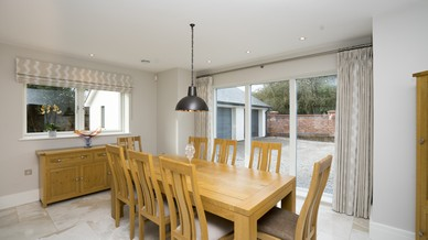 Dining area with small and large 3 panel alu clad window from Rationel.