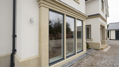 External view of the tripple feature floor to ceiling alu clad windows.