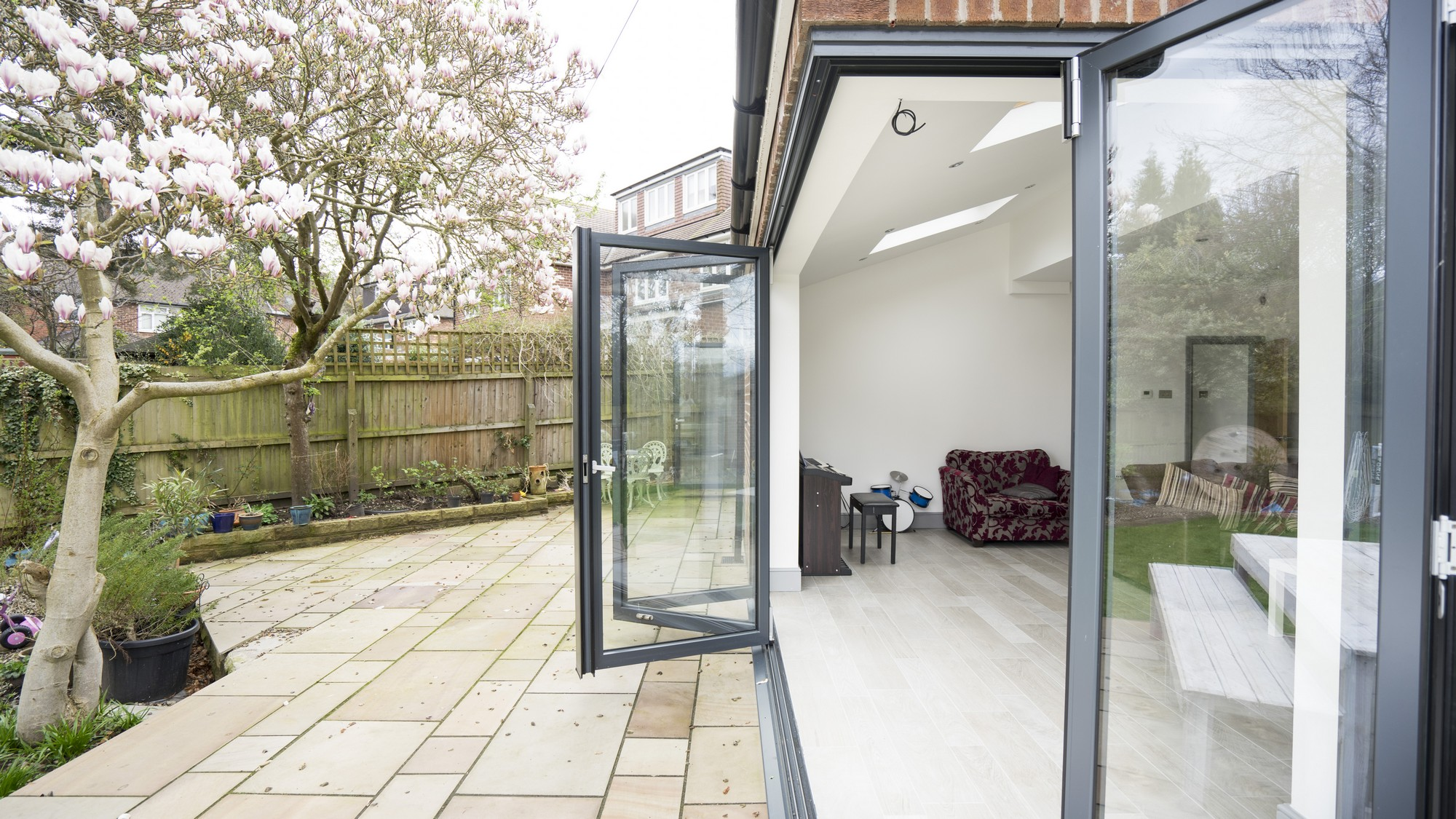 External shot of the RAL7016 aluminium bifolding doors showing the track and doors with the doors & Aluminium Bi-folding Doors Liverpool   John Knight Glass