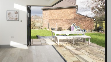 Internal view of the fully open corner-less bifolding doors looking out onto the garden.