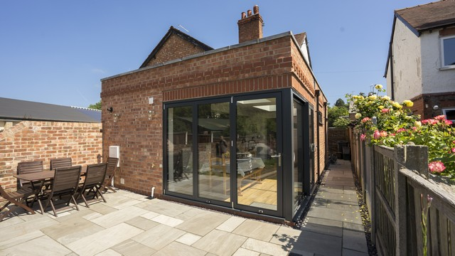 External image of this brick extension with the doors closed.