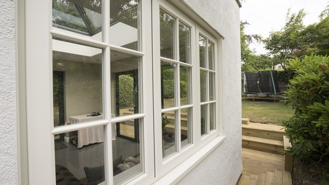 Traditional UPVC timber style window from Evolution giving a period appropriate look to the home.