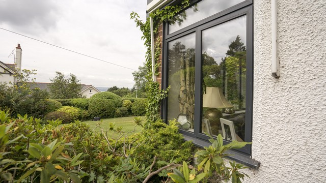 Corner angle of the aluminium side windows showing views over the Dee Estuary.