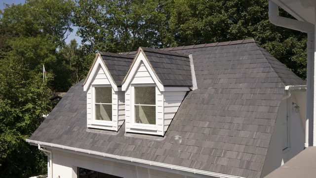 Dual roof dormers with Rationel alu-clad windows.