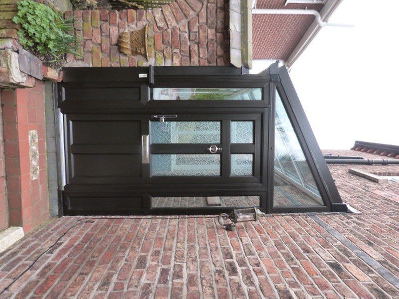 Oxton Wirral Design And Build Black Ash PvcU Porch Complete With Evolution Storm Front Door Glazed A Pilkington Glass Oriol Colletion Sandblasted