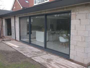 Triple glazed sliding doors installed in Bebington, Wirral. Product supplied by Sliders in powder coated aluminium.