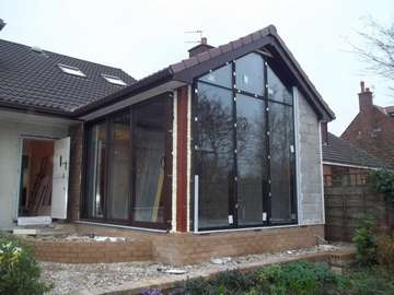Aluminium Curtian walling glazed with self Clean glass, triple track Patio doors OXX .