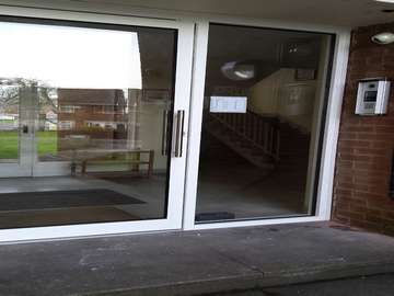 Arrowepark Wirral. Shopline Polyester powder coated Entrance doors . Double glazed . Key pad opening