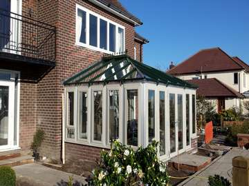 Caldy wirral. Installtion of Evoltion Storm windows and doors . double glazed . Argon gas filled . Bespokely painted . K2 Aluminium Traditional roof system