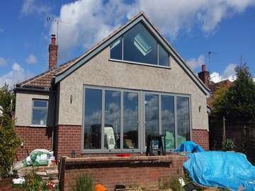 Installtion of Centor Triple glazed Bi fold doors in Heswall Wirral. The doors were triple glazed . The Shaped Aluminium Atrium style windows was fabricared to match the Bi fold doors