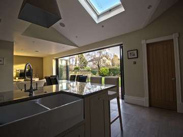 Internal view of modernised open plan living space with Centor bifold doors.