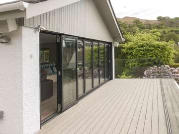 Making the most of the view yeah round with these stunning biffold doors adding the ultimate wow factor to this indoor outdoor living space.