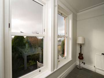 Dual Bygone UPVC sliding sash windows fitted with bronze hardware and double glazed panels in Heswall, Wirral.