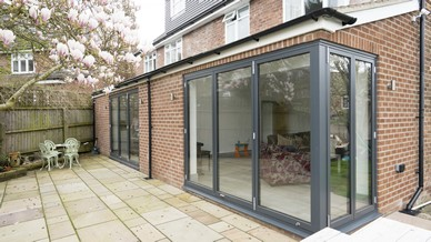 Overview of the dual bifolding door installation showing the ground floor extension externally.