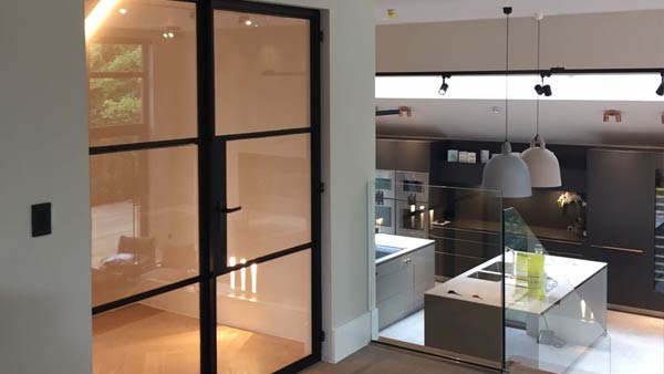 Internal Crittall screen installed on a project in Manchester. A matt black finish with matching hardeware adds an industrial edge to thie contemporary home. Horizontal glazing bars further enhance the look of this door.