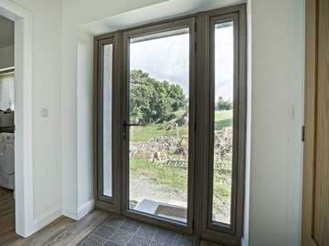 Internal shot of glazed door with dual sidelights.