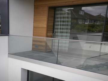slimline HUKE door system with Q Rail Balastrading