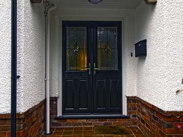 External shot of double composite door installed in Heswall.