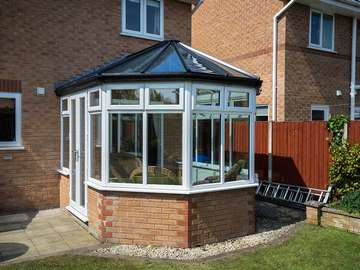 Alternative view of this replacement conservatory. The original base was in good order so was kept however the aluminium conservatory had seen better days and therefore was replaced with a brand new UPVC structure.