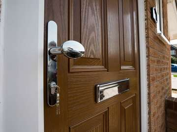 Close up of door handle and letterbox.