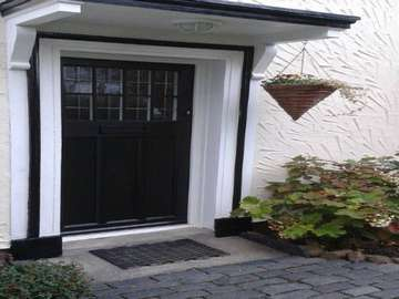 Traditional style timber alternative door in black with lead lighting from the English door company. Door recently fitted on the Wirral.
