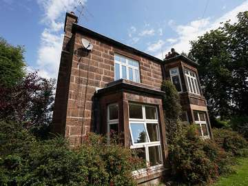 Evolution timber alternative UPVC windows installed throughout this sandstone property.