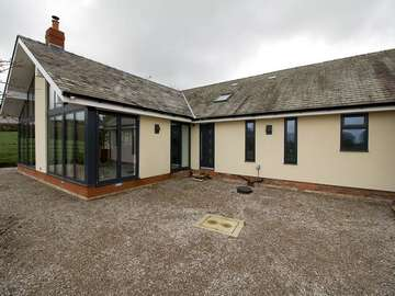 Photo shows original house with replacement windows and doors and new extension. All windows and doors supplied and installed by ourselves John Knight Glass.