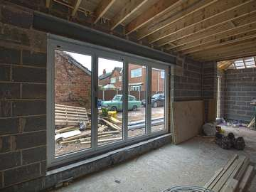 Internal view of aluminium Centor bifold doors installation in Formby, Liverpool.