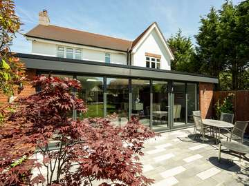 Large grey aluminium bifold doors with matching aluminium fascia boards supplied and fitted on the Wirral to complete this stuning open plan living space.