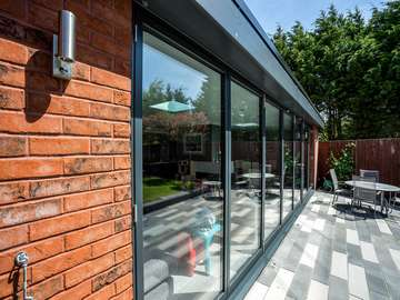 External close up of Aluminium bifold doors allowing lots of Natural light to flood into this property on the Wirral.