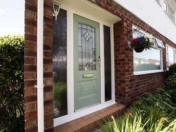 Portland Rockdoor in green, with dual frosted sidelights.