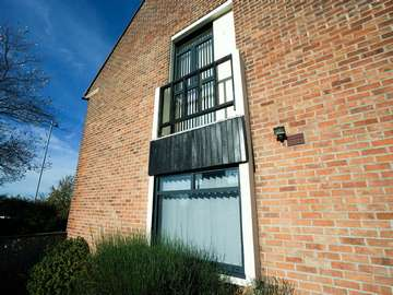 Grey aluminium windows fitted to the side of a traditional detached house in New Brighton, Wirral.