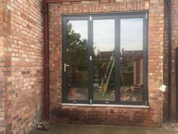 Grappenhall Cheshire. Installtion of Centor C1 Bi folding doors. 7017 Ral. Note Alumnium Threshold - triple glazed