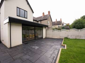 External view of large Dutemann black sliding door installed in Colwyn Bay, North Wales.