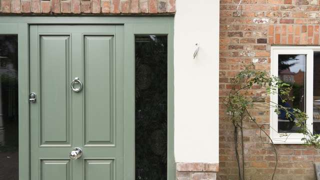 Close up of this stunning timber entrance door finish in matt green.