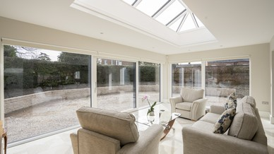 Large aluclad window and Internorm sliding door creating a garden room style to this space, complete with a large roof lantern.