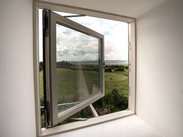 Rationel alu-clad triple glazing timber window making the most of the stunning views.