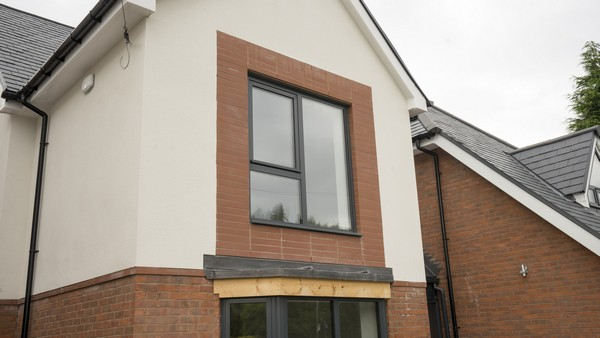Triple pane aluminium window, sits well with the red brickwork and contrasting cream k-rend.