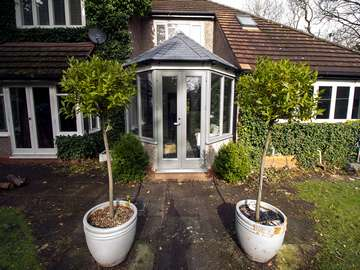 Old tired and rotten timber conservatory with polycarbonate roof replaced with insulated roof and Rationel alu-clad timber windows and doors. Overall U value has been vastly improved creating a space that is warm, comfortable and usable all year round.